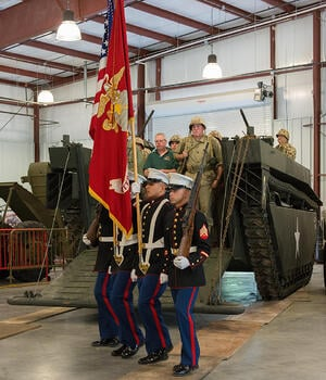 Amphibious Assault Tank with Marines carrying Flag