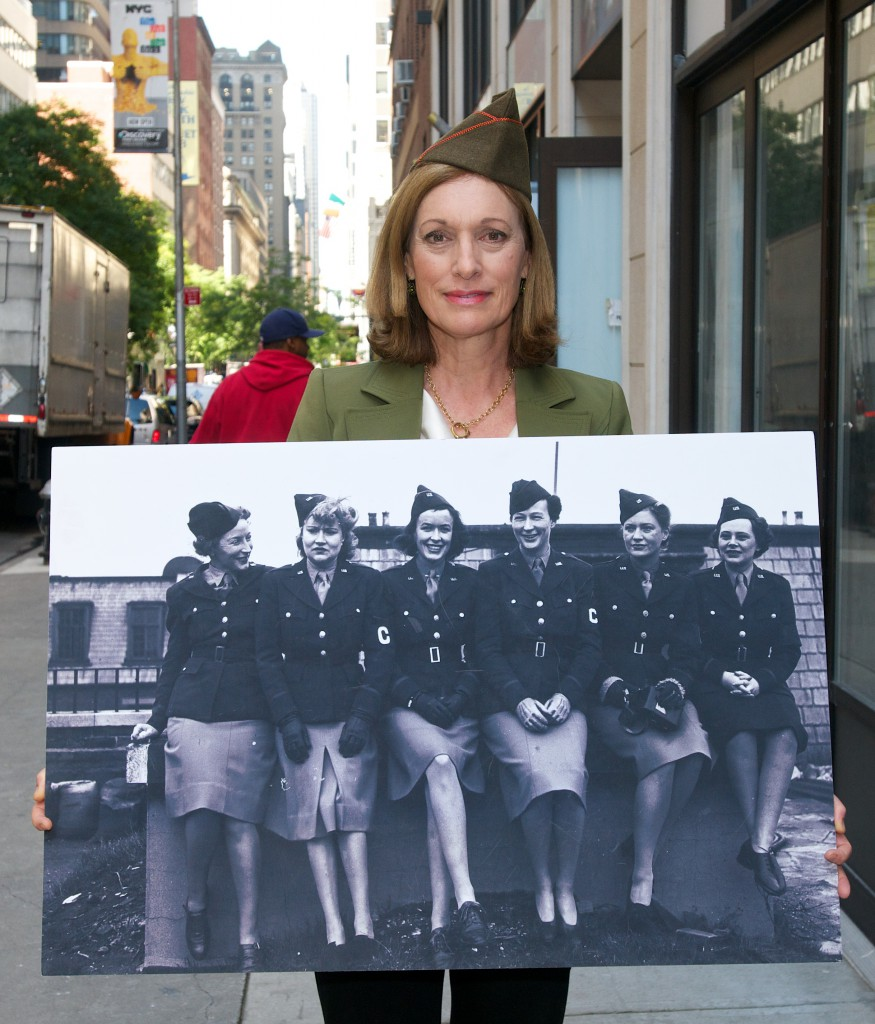 Dr. Libby O'Connell, Chief Historian at the History Channel with a photo of WWII women war correspondents