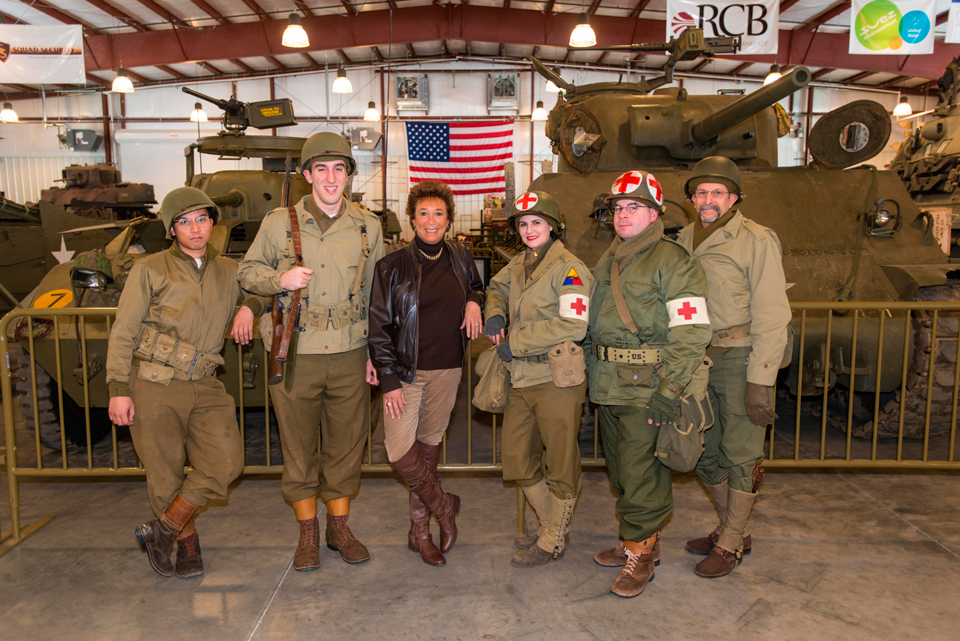 Stop & Shop's Arlene Putterman is surrounded by WW II living historians at the Museum of American Armor