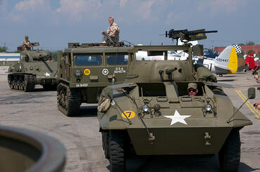 Tanks and Truck driving on flightline of Airshow