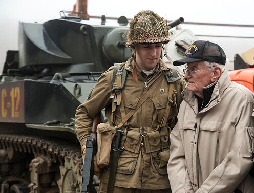 WWII enactor helping WWII elderly veteran